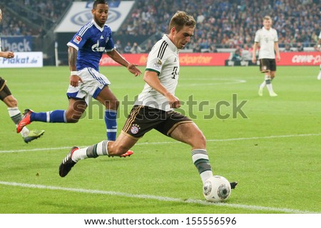 SCHALKE, GERMANY - SEP 21: Philipp Lahm (FC Bayern) during a Bundesliga match between FC Schalke 04 & FC Bayern Munich, final score 0-4, on September 21, 2013, in Schalke, Germany. - stock photo
