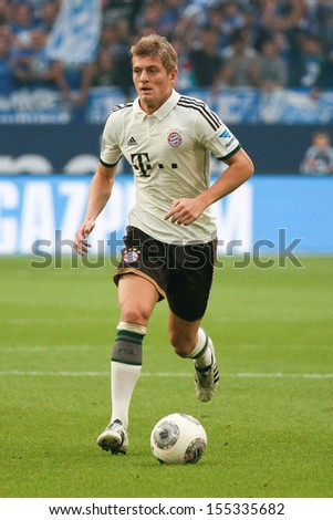 SCHALKE, GERMANY - SEP 21: Toni Kroos (FC Bayern) during a Bundesliga match between FC Schalke 04 & FC Bayern Munich, final score 0-4, on September 21, 2013, in Schalke, Germany. - stock photo