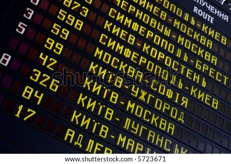 Schedule bord at a railway station with cyrillic letters - stock photo