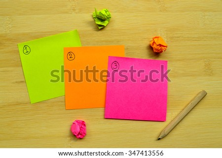 Schedule in next day on post it notes - stock photo