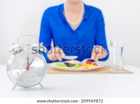 Schedule of the day. Day. Woman having dinner. - stock photo