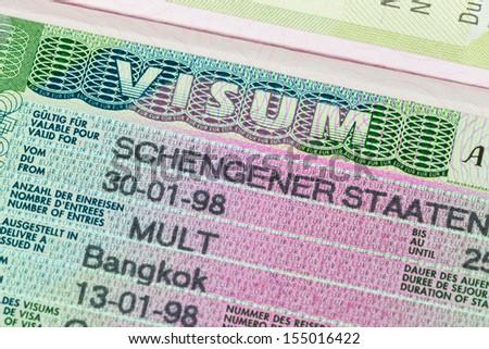Schengen visa in passport macro - stock photo