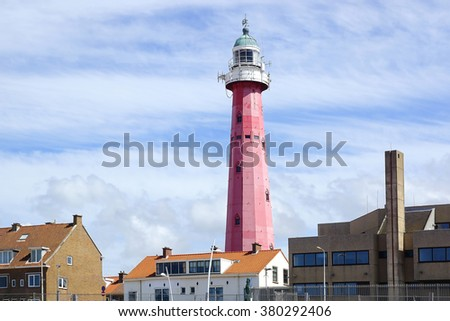 SCHEVENINGEN, BELGIUM - AUGUST 02, 2012: Scheveningen lighthouse. Lighthouse designed by Quirinus Harder was completed in 1875 and has the status of a national monument.