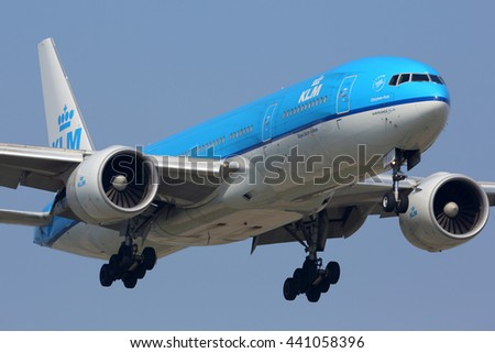 SCHIPHOL, AMSTERDAM, NETHERLANDS - APRIL 3, 2016: Boeing 777-200 of KLM Royal Dutch Airlines landing at Schiphol international airport.