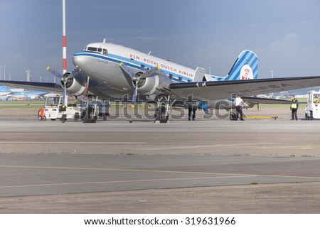 Schiphol, Netherlands - AUGUST 29, 2015: Vintage style plane parked at Amsterdam International Airport in The Netherlands. - stock photo