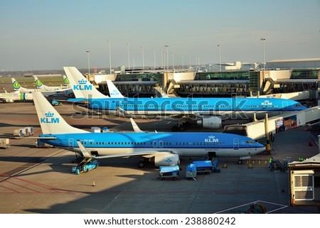 SCHIPHOL, NETHERLANDS - Nobember 21, 2014: KLM or Royal Dutch Airlines in English is the flag carrier airline of the Netherlands. - stock photo