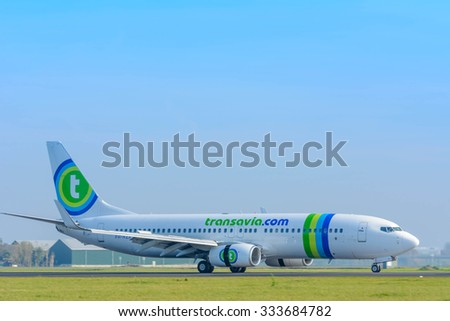 Schiphol, Noord-Holland/Netherlands- September 18-09-2015 -Plane from Transavia PH-HZX	Boeing 737-800 is started landed at Schiphol Airport. Photo taken during daylight, typical aviation background.  - stock photo