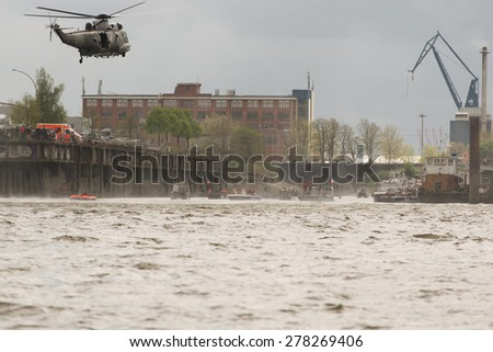 Schleswig Holstein, Germany, May 09, 2015: Exercise a sea rescue by helicopter at the Hamburg Harbour Birthday on May 9th, 2015 - stock photo