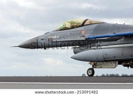 SCHLESWIG-JAGEL,  GERMANY - JUN 23, 2014: An F-16 on the runway during the NATO Tiger Meet at Schleswig-Jagel airbase. The Tiger Meet is to promote solidarity between NATO air forces - stock photo