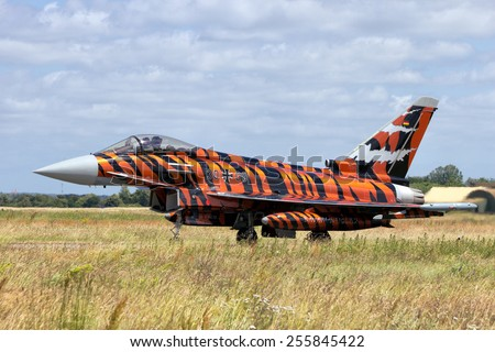 SCHLESWIG-JAGEL, GERMANY - JUN 23, 2014: Tiger painted German Eurofighter Typhoon during the NATO Tiger Meet at Schleswig-Jagel airbase. The Tiger Meet is to promote solidarity between NATO air forces - stock photo