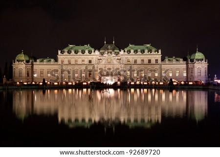 Schloss Belvedere at night with Christmas Market in Vienna, Austria. - stock photo