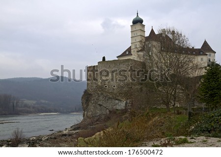 Schloss Schoenbuehel is a castle the right bank of the Danube  - stock photo