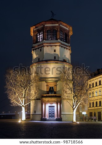 Schlossturm (the extant tower of Dusseldorf castle) in night illumination, Dusseldorf, Germany - stock photo