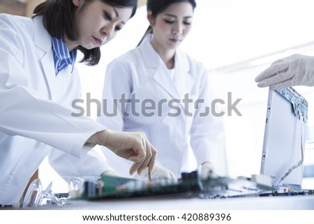 Scholars learn the knowledge of the machine. Studying to become a bridge to the future. - stock photo