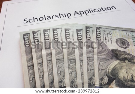 Scholarship application form with hundred dollar bills                                - stock photo