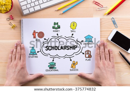 SCHOLARSHIP sketch on notebook - stock photo