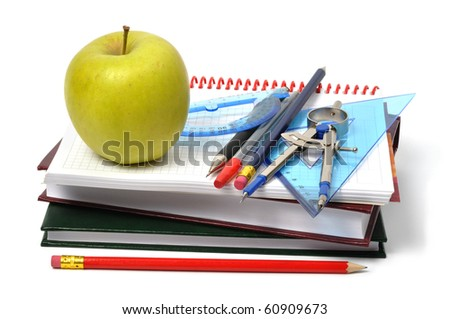 School accessories and apple on white background