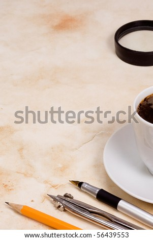 school accessory and coffee at paper - stock photo