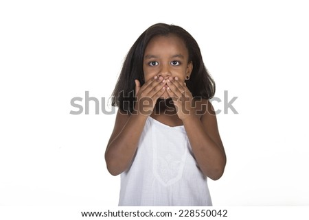 School aged child covering her mouth isolate on white - stock photo