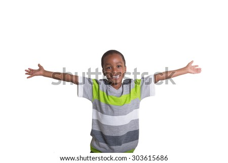 School aged child with his arms out