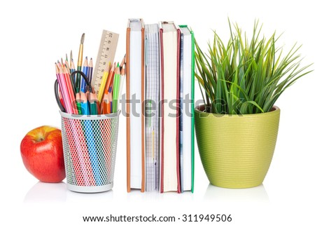 School and office supplies. Notepads, colorful pencils, flower and apple. Isolated on white background - stock photo