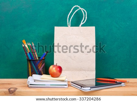 School and office supplies on the wooden table - stock photo