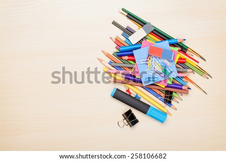 School and office supplies over office table. Top view with copy space - stock photo