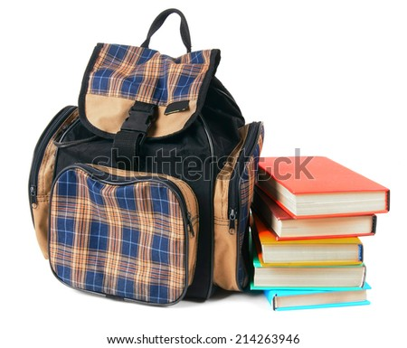 School backpack and books. On a white background. - stock photo
