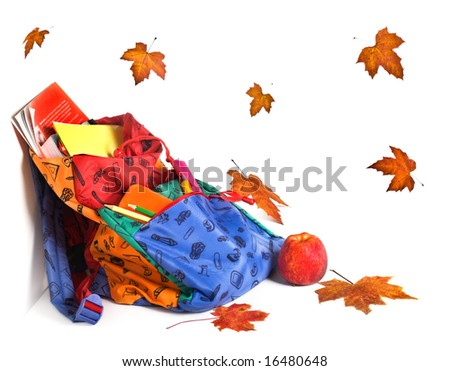 School backpack, apple and autumn leaves - stock photo