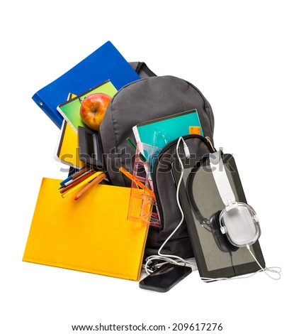 School backpack with supplies and a tablet with headphones. School backpack ,notebooks, tablet, headphones, ruler, book, apple. - stock photo
