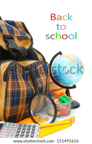 School bag, a magnifier, the globe and other school accessories on a white background. - stock photo