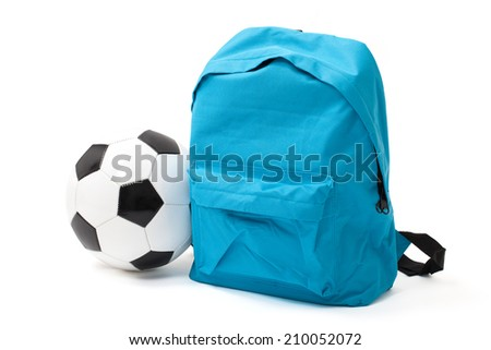 School bag and ball with clipping path on white. - stock photo