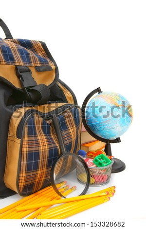 School bag and other school accessories on a white background. - stock photo