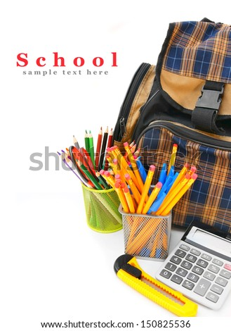 School bag and school accessories on a white background. - stock photo