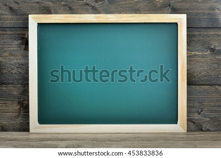 School board on wooden table - stock photo