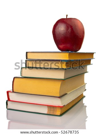 School books with apple on white background
