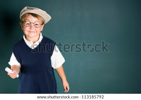 school boy at chalkboard - stock photo