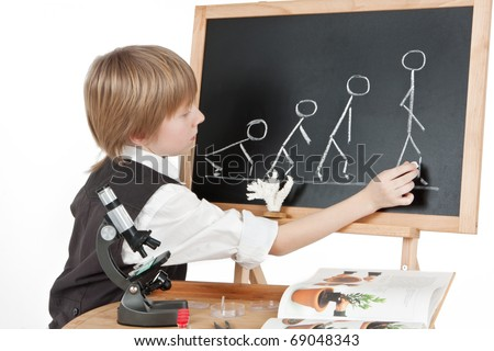School boy doing biology homework - stock photo