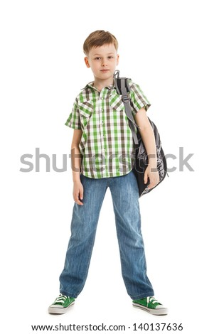 school boy in jeans with a backpack isolated