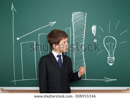 school boy in suit show column graphs on board