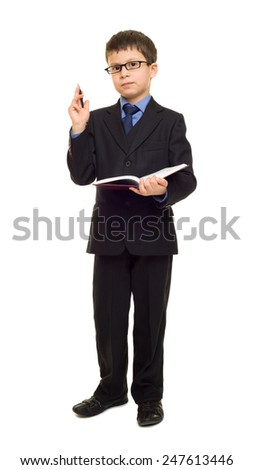 school boy in suit write diary - stock photo