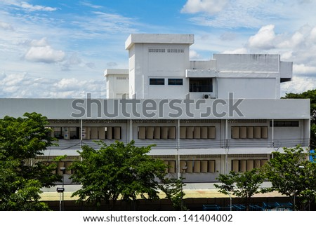 School building with blue sky background - stock photo