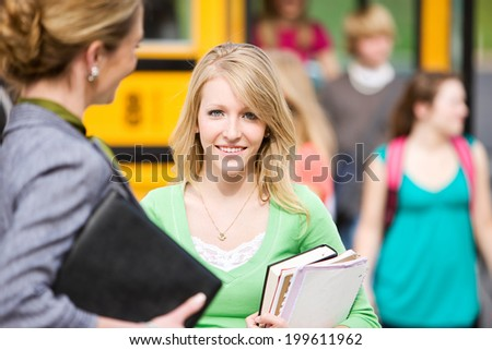 School Bus: Smiling Student Talking With Teacher