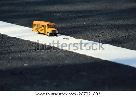 school bus toy model - stock photo