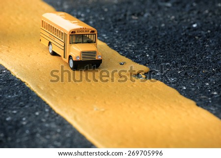 School bus toy model. - stock photo