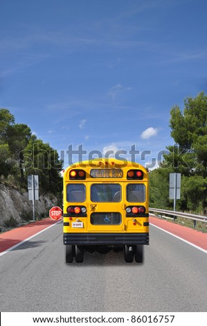 School Bus with Handicap Symbol on Street Sunny Blue Sky Day - stock photo
