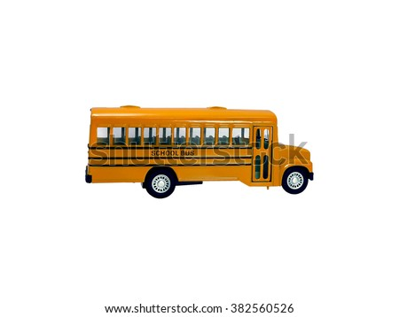 School bus with white top isolated on a white background.Yellow school bus toy model isolated on a white background. - stock photo