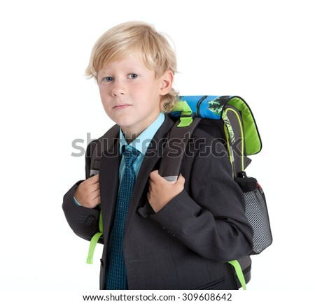 School Caucasian pupil with schoolbag hanging on the back, isolated on white background - stock photo