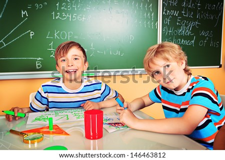 School children studying in classroom. Education. - stock photo