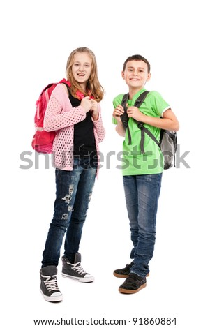 School children with backpacks - stock photo
